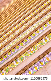 A closeup of a very famous Sicilian staircase with ceramic tiles on each step.