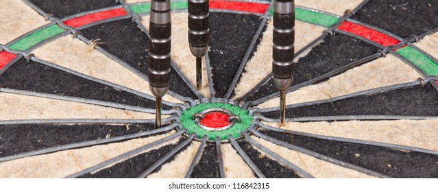 Close-up of a very old dartboard, isolated