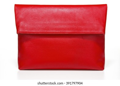 Closeup of vibrant red leather clutch on white background
