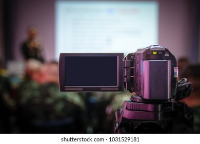 Closeup Video Cameraman taking photograp to the stage, event and seminar productio