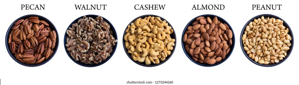 Close-up View from above of healthy Pecans, Walnuts, Cashews, Almonds and Peanuts in a Bowl isolated on white Background. Mix of healthy Nuts in a Row.