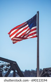 Close-up view of the American flag waving in the street