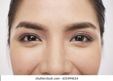 The close-up view of Asian girl eye on white background