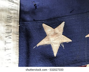 Closeup view of a battered vintage flag