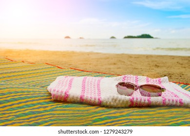 Closeup view of beach accessories on seaside. Travel and vacations concept. Luxury spa resort background with copyspace.