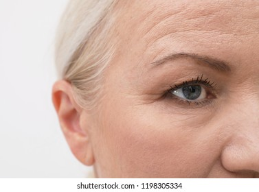 Closeup view of beautiful older woman on white background