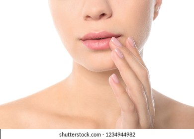 Closeup view of beautiful young woman on white background. Lips contouring, skin care and cosmetic surgery concept