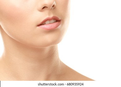 Closeup view of beautiful young woman with natural lips makeup on white background
