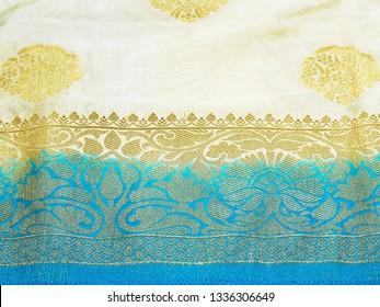 Closeup view of a blue Banarasi silk sari. These exquisite, expensive sarees are famous for their gold and silver zari, brocade.