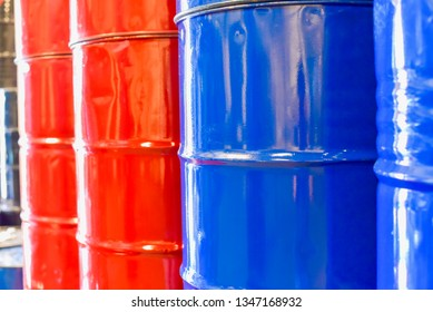 Close-Up View of Blue and Red Industrial Chemical Drums