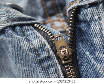 Closeup view of BlueJeans zipper.