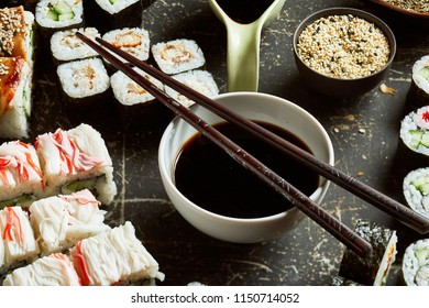 Close-up view of bowl of soy sauce with wooden chopsticks on the top