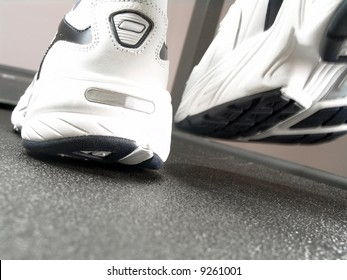 Closeup view of brand new sport shoes running on a treadmill