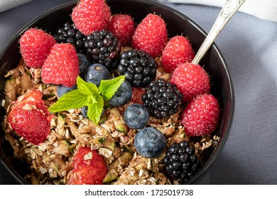 Closeup view of breakfast bowl with cereals berries and mint