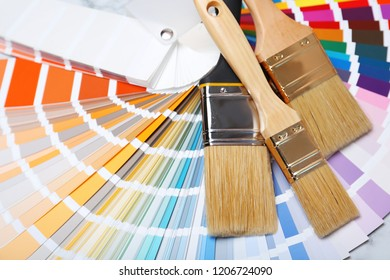 Closeup view of brushes and paint color palette samples