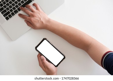 Close-up view of businessman typing on blank screen computer laptop in comfortable room