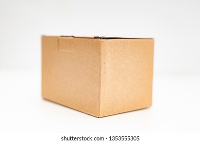 close-up view of a cardboard box over white background