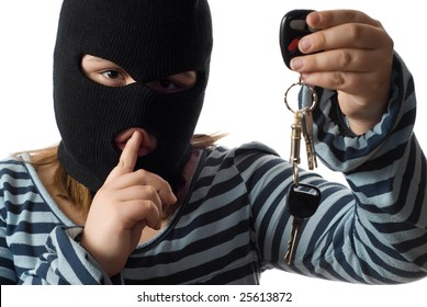 Closeup view of a child stealing some car keys, isolated against a white background