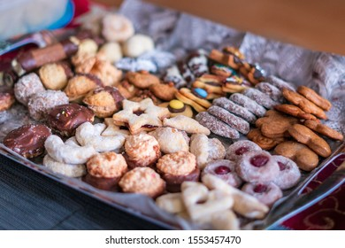 Close-up view of Christmas sweets. Many different kinds and variations of Christmas cookie. Stars, tubes, baskets, linzer or gingerbread sweets.