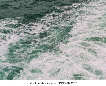 Close-up view of churning white wake, from the back of a boat crossing the English Channel