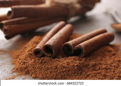 Closeup view of cinnamon sticks and powder on table