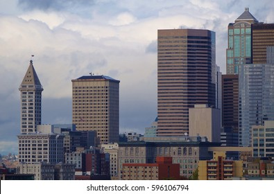 Closeup view of city buildings in the skyline of Seattle, Washington on a nice but somewhat cloudy autumn day. The city's oldest highrise, Smith Tower, is to the left in this picture from Rizal Park.