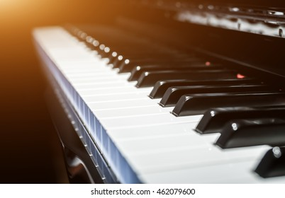 Closeup view of classical piano keys in modern black and white style with natural tones and warm colours