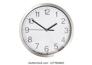 Close-up view of clock isolated on white - deadline and time concept