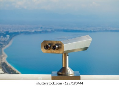 Closeup view of coin operated binocular viewer for looking in details at beautiful summer sea landscape. Antalya, Turkey. Happy summer holidays and sightseeing concept. Horizontal photography.