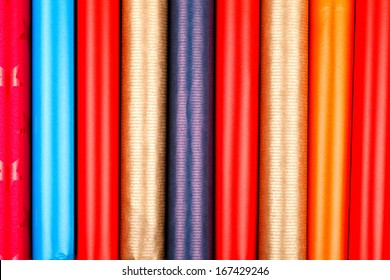 Closeup view of colorful wrapping paper rolls