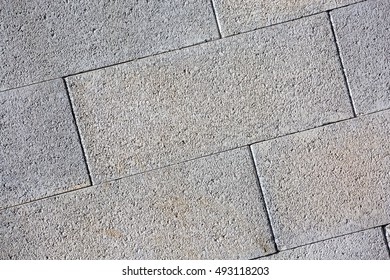 A close-up view of concrete blocks in a wall patterned background