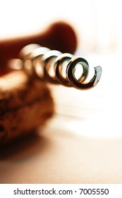 Close-up view of cork-screw on background