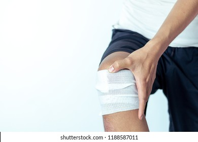 Close-up view of Cotton bandage over a wound on knee, accidents concept photo.