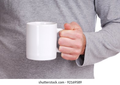 Closeup view of a cup in man's hand