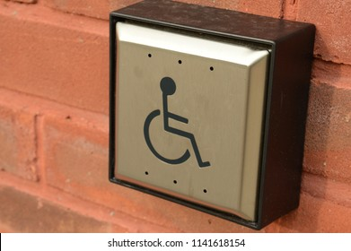 Closeup view of a disability door access button for easy entrance of the public building.