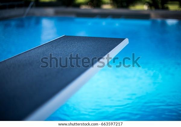 Closeup view of diving board in swimming pool