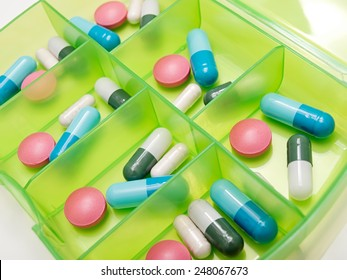 Closeup view of drugs in a box as a weekly dosage or therapy.