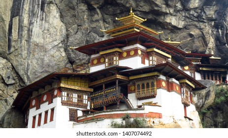A closeup view of the entire Tigers Nest Monastery built in a high cliff over the valley in Paro, Bhutan