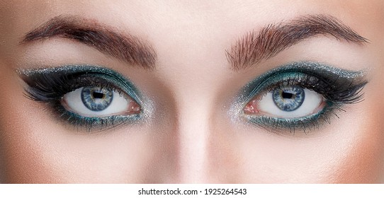 Close-up view of the eyes of a young girl with beautiful makeup