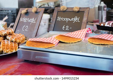 Close-up view of famous holland waffles (Dutch stroopwafel, caramel waffle) in chequered cover with price on market counter in the Netherlands