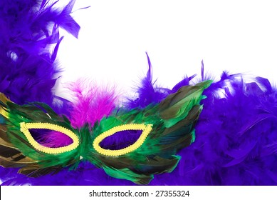 Closeup view of a feathered masquerade mask, isolated against a white background