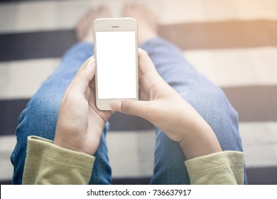 Closeup view of female hands touching mobile phone,smarphone screen on white