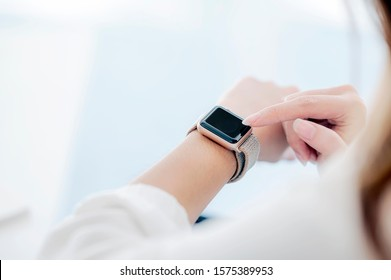 Closeup view of female using smartwatch application, touching on screen, copy space.