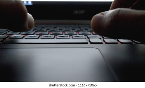 Close-up view fingers tapping keypad of laptop and writing message