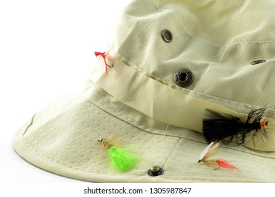 Closeup view of a fishermans hat with some fly bait hooks for easy access.