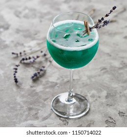 Close-up view of fresh alcohol cocktail on grey table