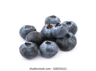 Close-up view of fresh blueberries isolated on white background