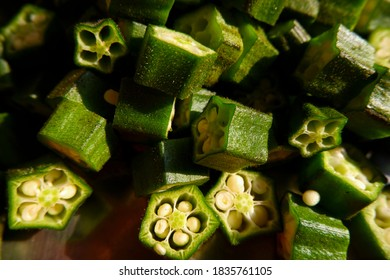 closeup view of fresh green lady finger pieces isolated on pan