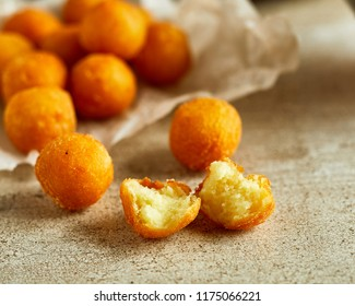 Close-up view of fresh homemade cheese balls on wooden cutting board
