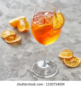 Close-up view of fresh orange alcohol cocktail on grey table